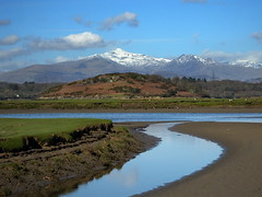 A snow capped Snowdon with Ynys Gifftan in the foreground