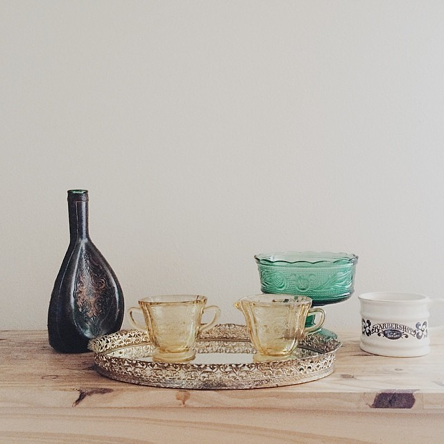 Today's vintage finds for the shop: tooled leather clad glass decanter, metal filigree mirror tray, yellow princess depression glass sugar bowl and creamer, green pedestal dish, shaving cup. More deets and a sob story over at thriftanthology.tumblr.com.