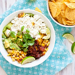 Guacamole with Grilled Corn, Bacon, and Goat Cheese