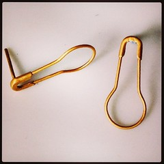 Gold plated safety pin earrings! And they still work, so you could dangle little charms from them.   Would you be more likely to buy them if they were hallmarked, or are you not bothered?