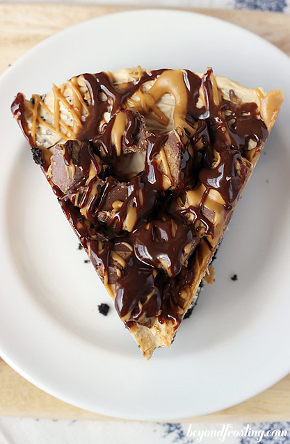 Mouthwatering No-bake Reese's Peanut Butter Cup Cheesecake- rich peanut butter cheesecake in a Oreo cookie crust.