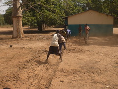 4 villagers digging out the footing's trench for the wall foundations
