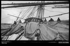 Crew attending to sails on board the training ship MERSEY