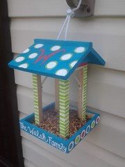 our cute little bird feeder we painted