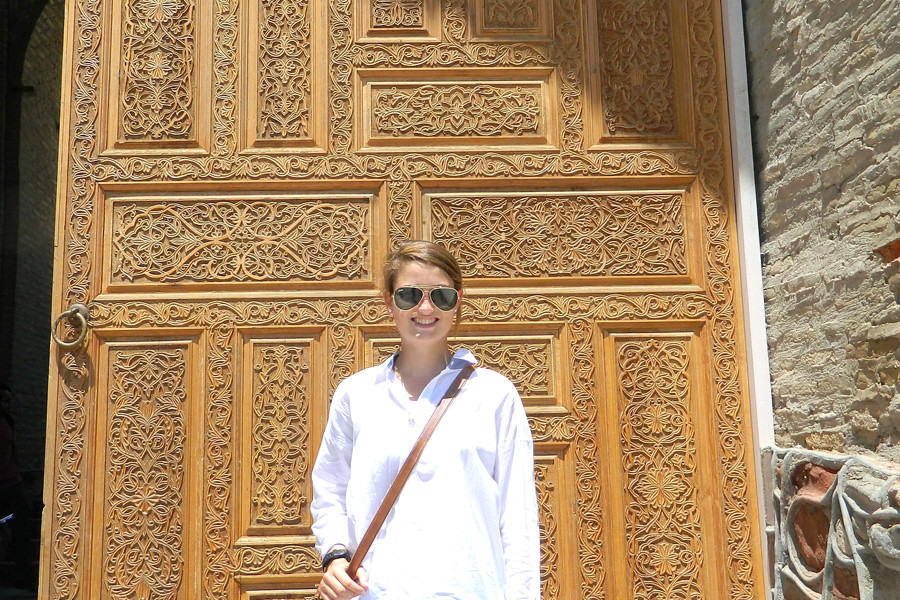 July 1, 2014 - Critical Language Scholar Ellen Hubbard, who graduated in May with a double major in foreign affairs and Middle East studies, stands at the entrance to the historic Hisor Fort southwest of Dushanbe, Tajikistan.