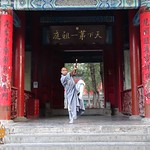 Shifu Shi Yan you Poses at the Shaolin Temple Entrance