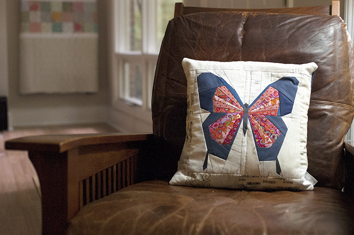 1 Butterfly Pillow in leather chair