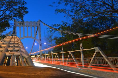 city bridge light red trails honduras