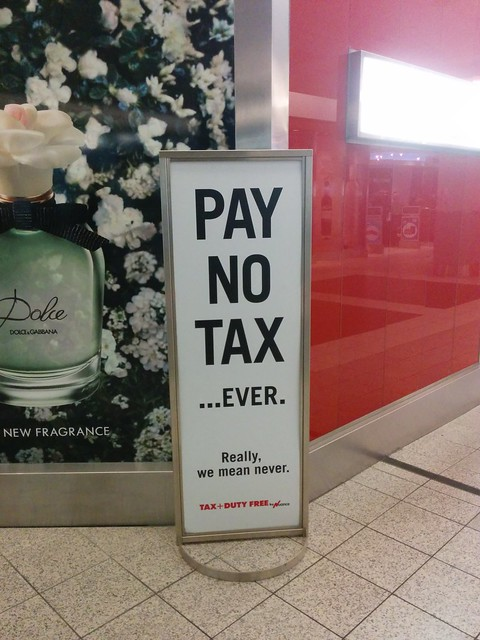 Pay No Tax Ever sign, duty free, sign, Pearson Airport T3, Toronto, ON, Canada from Flickr via Wylio
