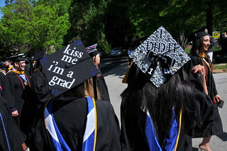 "Commencement caps that say ""kiss me I'm a grad"" and ""I did it."""