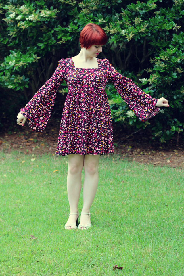 Retro Late 60s Early 70s Style Floral Print Bell Sleeved Dress with a Square Neckline and some White Heels
