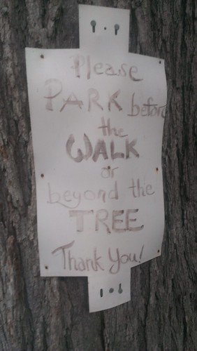 Please park before the walk or beyond the tree. Thank you.
