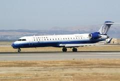 Canadair RJ United Express eXplus N758SK at SFO 28L u_DSC_0346_rj