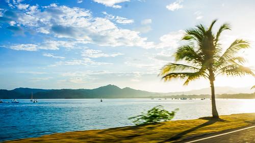 morning beach sunrise costarica palm montains sonynex5n
