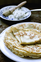 Pancakes with cottage cheese on the old brown plat…