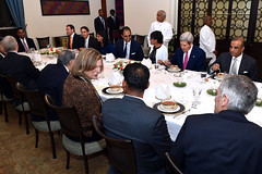 U.S. Secretary of State John Kerry and U.S. Commerce Secretary Penny Pritzker sit down to a working dinner on July 30, 2014, with Indian and American businessmen at Roosevelt House - the U.S. Ambassador's Residence in New Delhi, India - after the two Cabinet members traveled for a Strategic Dialogue with their Indian counterparts. [State Department photo/ Public Domain]