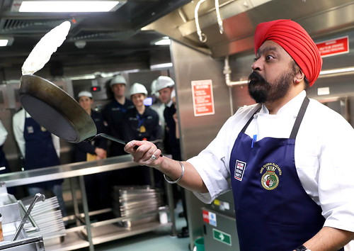 HMS QUEEN ELIZABETH's Ship's Company were visited by renowned Scottish chef, Tony Singh MBE, who cooked up a storm to mark the annual baking bonanza of Shrove Tuesday.