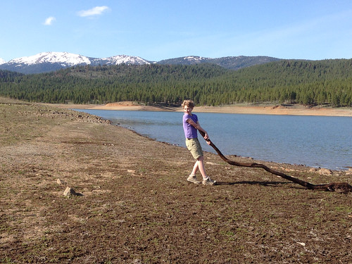 Easter hike, Phillips Lake. Heading up the beach with her branch!