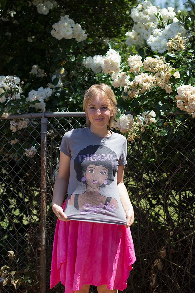 grey retro Barbie t-shirt, hot pink skirt, white roses