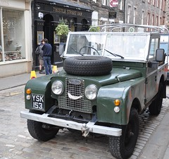 jeep(0.0), antique car(0.0), convertible(0.0), automobile(1.0), automotive exterior(1.0), military vehicle(1.0), vehicle(1.0), off-road vehicle(1.0), land rover series(1.0), land vehicle(1.0), luxury vehicle(1.0), motor vehicle(1.0),