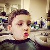 Sam making a face getting a haircut