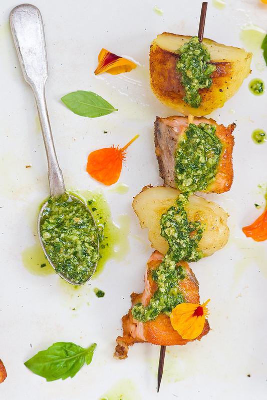 salmon and potatoes on sticks with pesto sauce.5