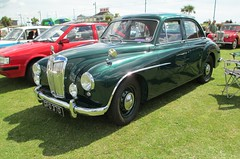 volvo pv444/544(0.0), automobile(1.0), vehicle(1.0), mid-size car(1.0), jaguar mark 1(1.0), compact car(1.0), antique car(1.0), sedan(1.0), classic car(1.0), vintage car(1.0), land vehicle(1.0), sports car(1.0),