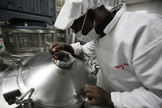 A Kenyan worker checks the mixing tank on a Ready to Use Therapeutic Food production line at Insta Products in Nairobi, Kenya.