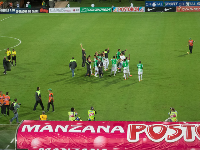 Nacional players and staff celebrate their semifinal victory