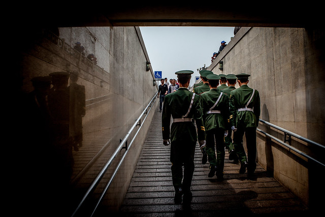 Chinese Guards Exiting Pedestrian Underpass in Beiijing