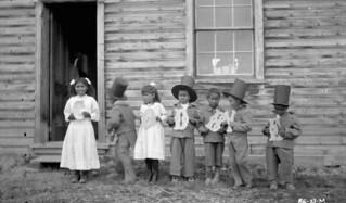 "Children at Fort Simpson Indian Residential School holding letters that spell ""Goodbye,"" Fort Simpson,... / Enfants au Pensionnat indien de Fort Simpson tenant des lettres formant le mot « Goodbye », Fort Simpson..."