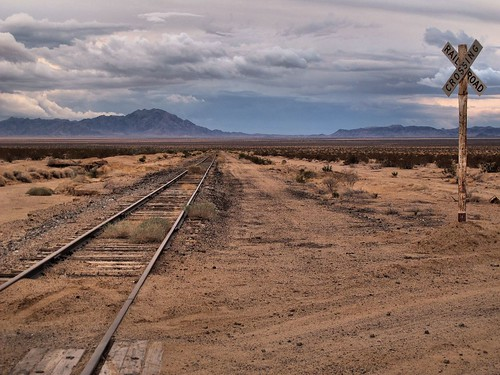 california sky mountains weather outdoors gloomy view desert empty tracks adventure remote lonely exploration desolate isolated stormclouds mojavedesert railroadcrossing railroadtracks waitingforatrain riversidecounty tonemapped threateningskies zoniedude1 canonpowershotg12 pspx6