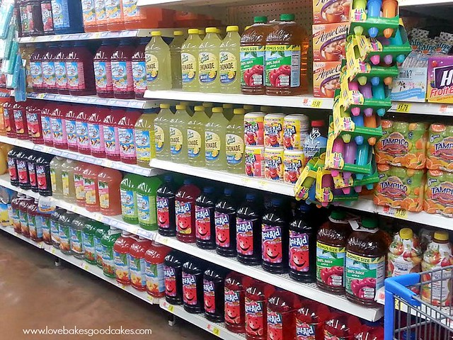 Grocery store isle with Kool aid products on shelves.