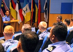 Lt. Cmdr. Wrighton of the Royal Malaysian Navy discusses action items during a Command Post Exercise brief as part of exercise Cooperation Afloat Readiness and Training (CARAT). (U.S. Navy/MC1 Tim Miller)