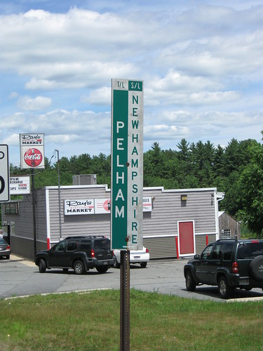photo of a road sign showing the state line on entering Pelham, NH