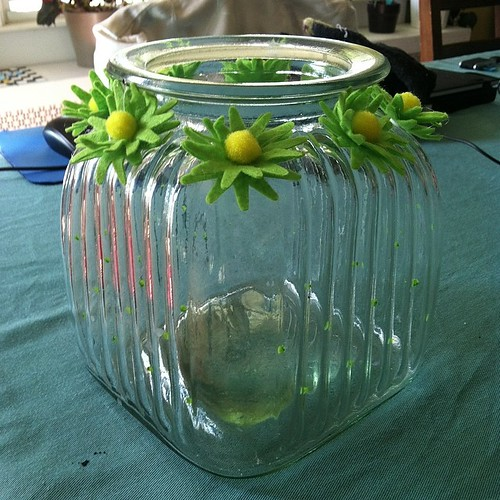 I updated my Home Goods jar with fun felt flowers from the dollar bins at Michael's Craft Store. #spring #simplecrafts