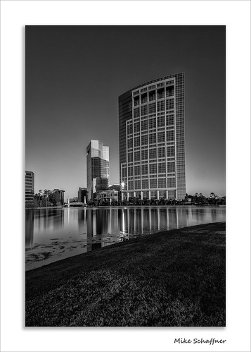 longexposure morning bridge lake reflection building tower water bulb architecture skyscraper reflections woodlands texas arch unitedstates squares curves shift sunburst tilt hackett anadarko thewoodlands lakerobbins canontse24mmf35lii