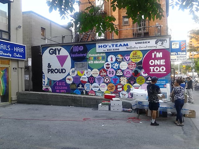 A mural of classic gay slogans