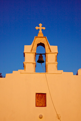 Small church in Mykonos town, orange from the setting sun
