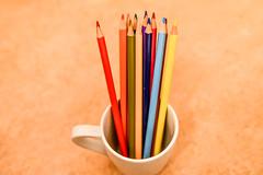 Multicolored Pencils in Coffee Cup