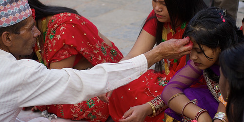 Nepali women being placed Tika on forehead during Woman Festival in Kathmandu, Nepal