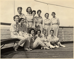 09-5069-29  U.S.S. Solace Nurse Unit. Front row: (Left-right) Ensign Mary Border (Pasadena, California); Ensign Pauline Toy (Mount Vernon, Missouri); Lieutenant (junior grade) Nell Seroka (Clifteon, New Jersey); Lieutenant (junior grade) Ruth Toenberg (Orr, Minnesota.) Middle Row: Ensign Hilda Smith...