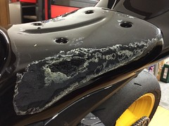 Seat rubber being removed.