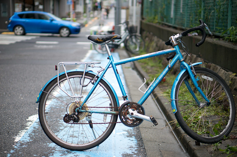 blue bicycle,blue car,blue road,