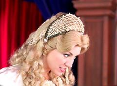 veil(0.0), bridal veil(0.0), clothing(1.0), headpiece(1.0), pink(1.0), headgear(1.0),