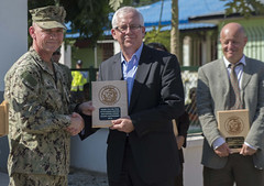 Capt. Rodney M. Moore, commodore of the 30th Naval Construction Regiment, presents a commemorative plaque to Peter Doyle, Australian Ambassador to Timor-Leste, during the closing ceremony for Pacific Partnership in Timor-Leste. (U.S. Navy/MC2 Derek Stroop)