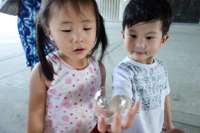 Showing off his bubble to girls. Tsk!