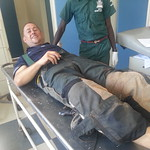 Steve on the bare metal gurney in triage at Mazabuka District Hospital, Zambia