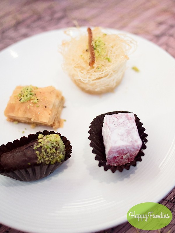 Dessert from top clockwise: Kanufa, Turkish delight, Dates and Baklava