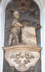 cherub unfurling a scroll for Timothy Balderton